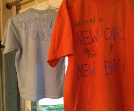 a blue and orange tee shirt decorated with puffy paint