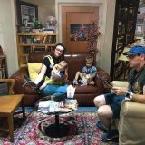 Our family relaxing in a replica set from The Big Bang Theory