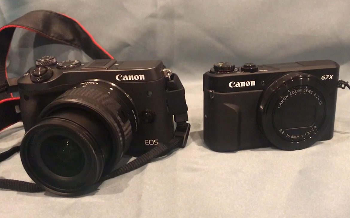 two cameras next to eachother, the canon eos m6 mirrorless camera vs. the canon g7x mark ii