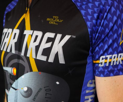 Closeup of a blue Star Trek cycling jersey featuring the Enterprise and delta logo, part of the fitness apparel line from Brainstorm Gear