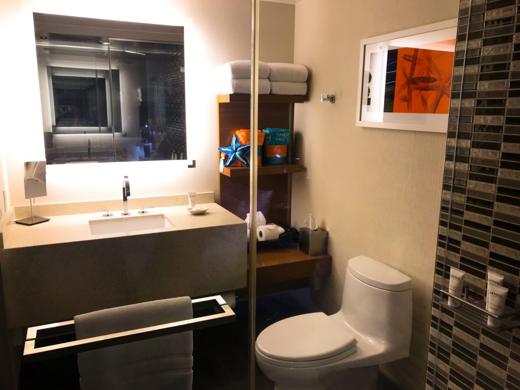 the bathroom at The Shore Hotel Santa Monica, viewing the sink and toilet area