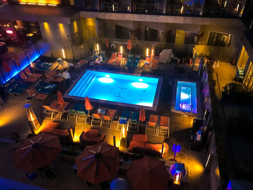 View of the pool and courtyard area from a balcony at The Shore Hotel Santa Monica
