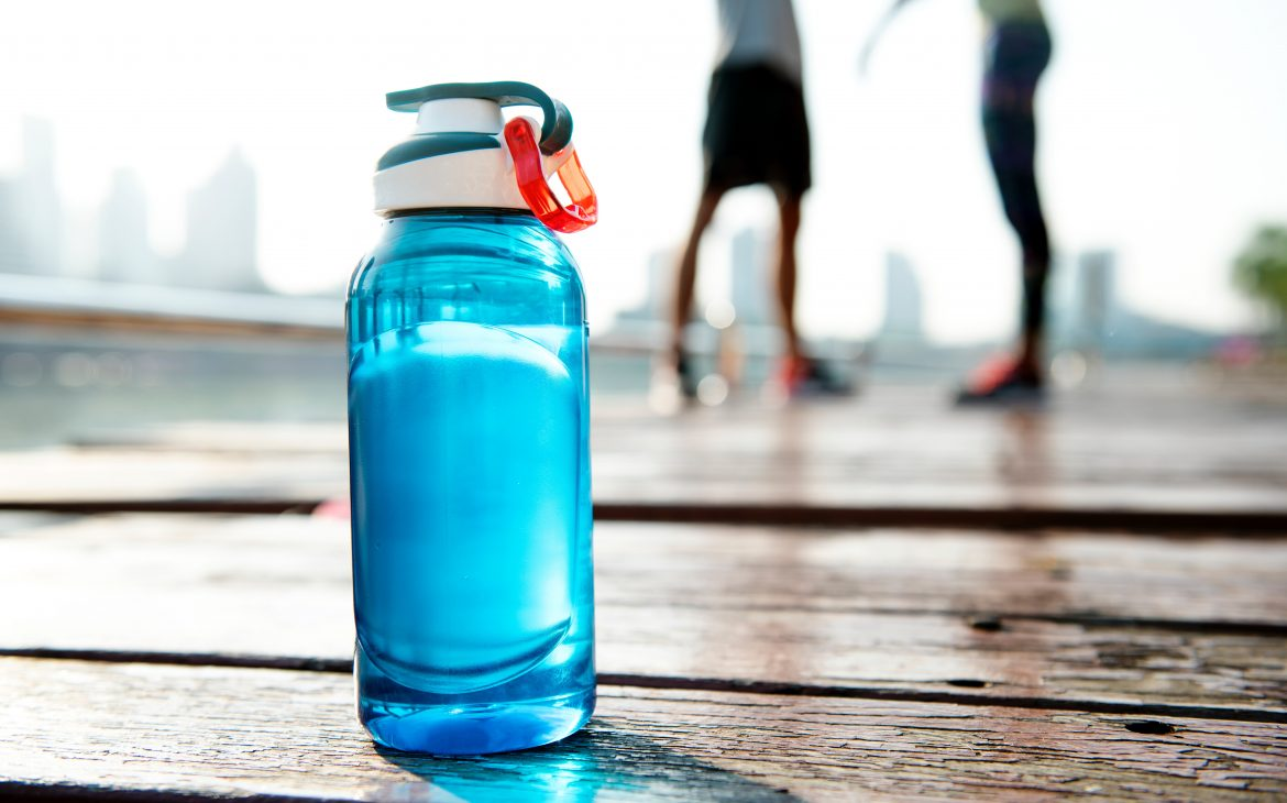 blue reusable water bottle with a cap and clip
