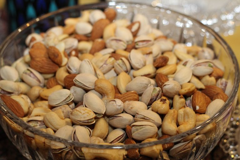 A bowl of cashews and pistachios, for the article on how to save money on food at theme parks