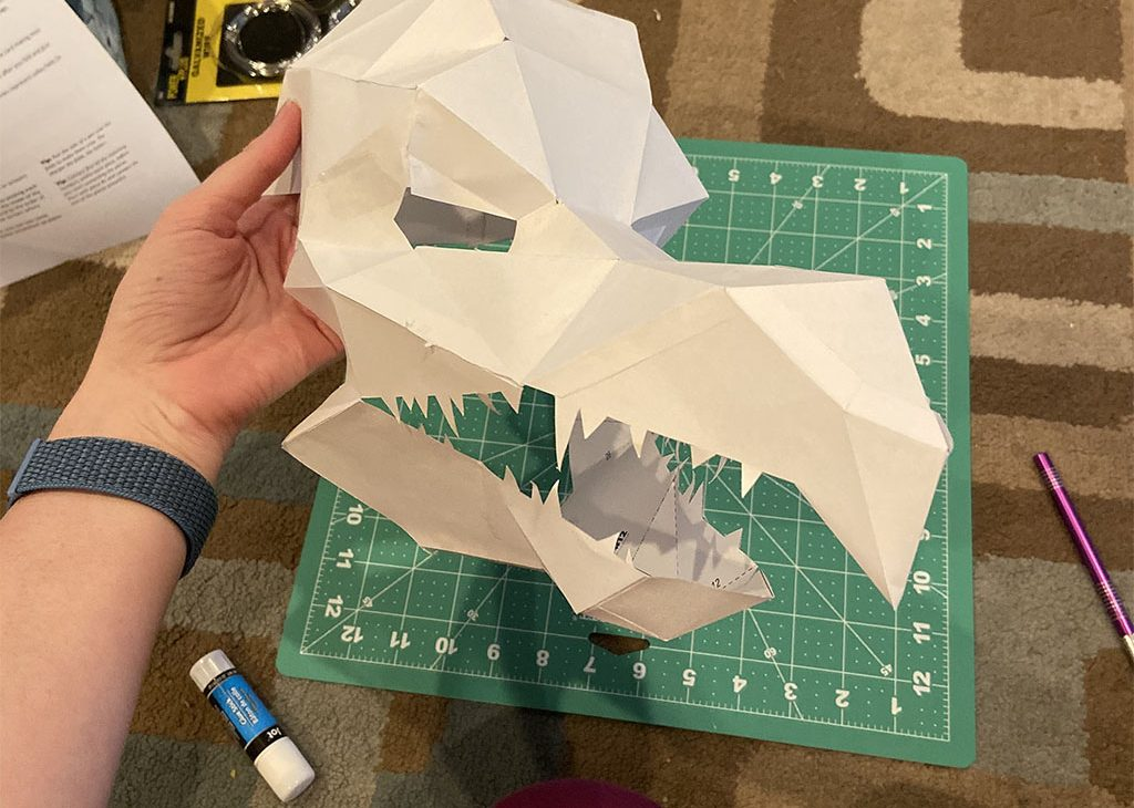 A Skeksis mask made out of paper