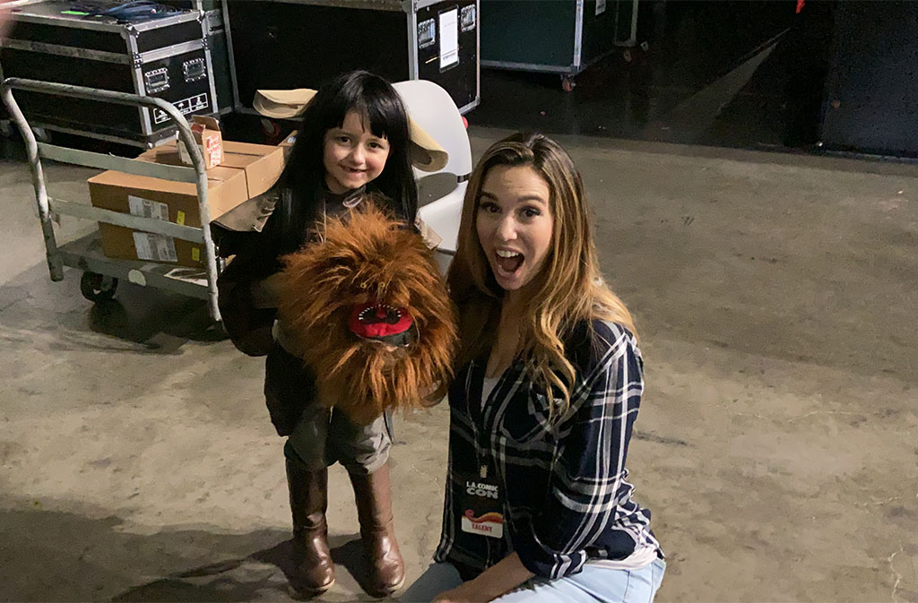 Actress Christy Carlson Romano with a Fizzgig puppet backstage at LA Comic Con