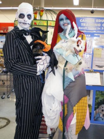 Jack Skellington and Sally cosplay Nightmare Before Christmas holding a dog and a cat
